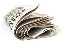 vik upp tidningen royaltyfri fotografi