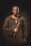 Viking with axes in a traditional warrior clothes.  Stock Image