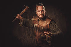 Viking with axes in a traditional warrior clothes.  Royalty Free Stock Images