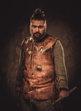 Viking with axes in a traditional warrior clothes royalty free stock photos