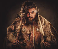 Viking with axes in a traditional warrior clothes stock images