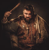 Viking with axes in a traditional warrior clothes royalty free stock photography