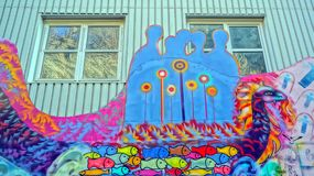 Viking boat colorful dragon head. Street graffiti and mural on the facade school students Norwegian Art School in Kragero. Edvard Munch Nearby painted his Stock Photos