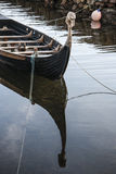 Viking boat at Corrie on the Isle of Arran. Viking boat replica in Corrie harbour, on the Isle of Arran in Scotland Stock Photo