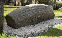 Viking carved hogback burial stone. Solid stone blocks were designed to make Viking tombs look like a classic Norse bow-sided house. This recumbent stone with an Royalty Free Stock Photo