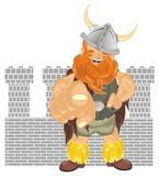 Viking and castle. Happy viking stand near of castle shadow and show gesture Royalty Free Stock Image