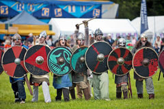 Viking charge. STOTFOLD, UK - MAY 12: Viking reenactors line up before making a demonstration charge at the public during the Milll show on May 12, 2012 in Royalty Free Stock Photo