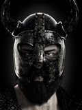 Viking close up wearing a helmet in black and white. royalty free stock photography