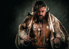 Viking with cold weapon in a traditional warrior clothes Stock Image