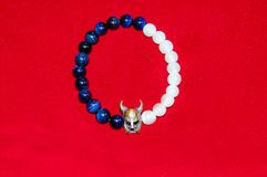 Viking figure blue and white bead men bracelet Royalty Free Stock Photos