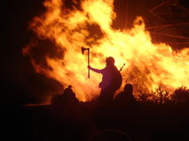 Viking by firelight. Silhouette of a Viking warrior against a raging bonfire Royalty Free Stock Images