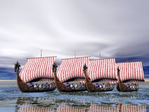 Viking Fleet of Ships. A fleet of viking raider ships on the sea Royalty Free Stock Photos