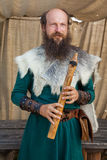 Viking flute player Stock Images