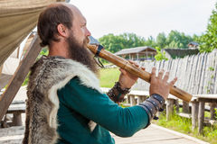 Viking flute player Royalty Free Stock Images