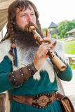 Viking flute player Royalty Free Stock Photography