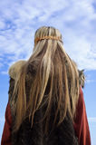 Viking girl on a blue sky background Royalty Free Stock Image