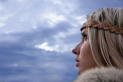 Viking girl on a dark sky background Stock Image