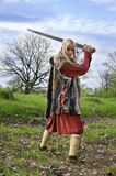 Viking girl warrior. With sword in a fight Royalty Free Stock Photography