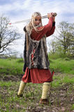 Viking girl warrior. With sword fighted stock photos