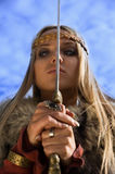 Viking girl warrior on a blue sky background Stock Photos