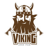 Viking head with a beard and axes Stock Photography
