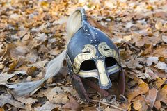 Viking helm. Old forged Viking helmet on a leaf Royalty Free Stock Photography