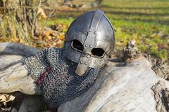 Viking helm. Old forged Viking helmet on a leaf royalty free stock images