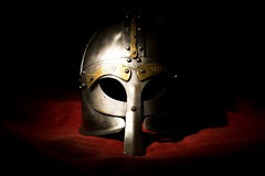 Viking helmet on background a red material.  Stock Photography