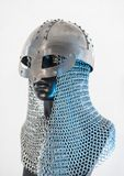 Viking helmet with chain mail in a black mannequin on white back Stock Photo