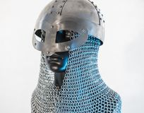 Viking helmet with chain mail in a black mannequin on white back Royalty Free Stock Images