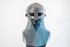 Viking helmet with chain mail in a black mannequin on white back Stock Images