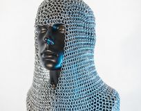 Viking helmet with chain mail in a black mannequin on white back Royalty Free Stock Photo