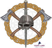 A Viking helmet, crossed axes and a Viking sword in a wreath of Scandinavian pattern Royalty Free Stock Image