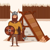 Viking with helmet with horns and axe, shield near lumbermill.  Royalty Free Stock Photography