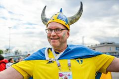 Viking in helmet with horns. Swedish smiling fan. stock photo