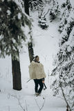 Viking hunter in pelt walking in snow winter forest with steel a Stock Photography