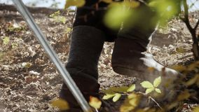 Viking legs climbing the slope stock footage