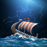 Viking medieval warship in stormy sea Stock Image