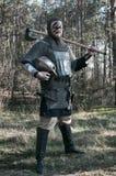 Viking podnosił jego cioskę na dzikim natury tle Zdjęcie Royalty Free