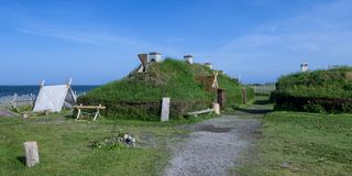 Viking settlement at L`Anse aux Meadows. Reconstructed buildings at an archaeological site on the northernmost tip of the island of Newfoundland in L`Anse aux stock photography