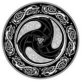 Viking shield, decorated with a Scandinavian pattern and Ravens of God Odin. Stock Photo