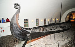 Viking ship. Oslo, Norway - 18 Dec, 2011: Tourists visiting the Viking Ship Museum (Vikingskipshuset) in Oslo