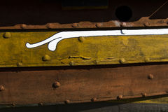Viking ship detail. Yellow on wood Royalty Free Stock Photo