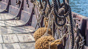 Viking ship fenders. On the deck, fenders are used to separate the ship from the harbor Stock Image