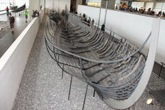 Viking Ship Museum (Roskilde) Denmark. Viking Ship Museum and Roskilde, Denmark. Large raised from the bottom of a ship in the middle of the room. Submerged ship Royalty Free Stock Image