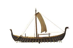 Viking ship with path. Boat model of a viking ship isolated on white with clipping path stock photo