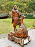 Viking ship,Viking man, Boat. Figure of man and viking boat carved from wood, Gudvangen, Norway royalty free stock images