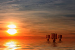Viking Ships. This image shows a sunset with sailing viking ships Royalty Free Stock Images