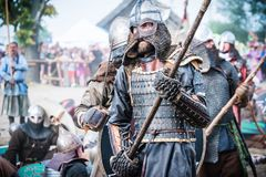Viking and Slav warrior in reenactment battle. stock photography
