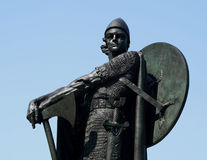 Viking Statue. A statue of the famous viking warrior Thorfinn Karlsefni, against a clear blue sky Royalty Free Stock Photos